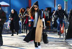 At Jeremy Laing Céline coat, Calvin Klein Collection pants, Saint Laurent bag