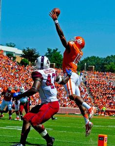 Clemson wide receiver Charone Peake leaps for a pass over South Carolina State's Justin Hughes. (Richard Shiro/AP)