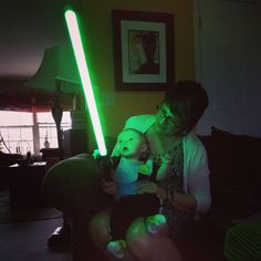 My baby nephew seeing a lightsaber for the first time