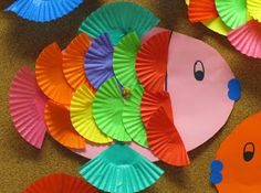 "Cupcake wrapper fish craft for children.  Cute to add to ""Rainbow Fish""!"