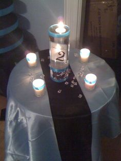 Floating Candle Centerpiece :  wedding black blue bouquet cake ceremony…