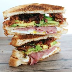 Ultimate Breakfast Club Sandwich. Avocado, Bacon, Egg, Cheese and Ham. What more could you possibly need in a sandwich?.