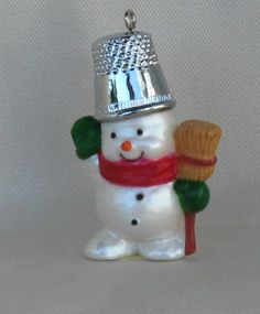 Snowman with thimble hat.  11th in series of ornaments by Hallmark 1988