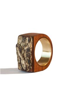 Wood ring made of yew wood. This ring is handmade following the natural veining of wood. Yew is an uncommon wood, once very common in Europe. It was the best wood for bows making. I made this ring from a branch that was broken by the snow. This ring is one of a kind. Inside made of brass.  Size (internal diameter): 0,67 inches 17 mm  For any question or doubt dont hesitate to write me