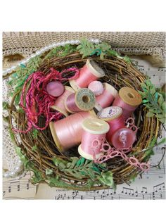 Sweet vintage thread spools in a bird's nest bowl