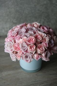 Pink roses are a cheerful token of spring: 'Charity in Bloom' by Winston Flowers.