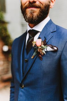 There's a serious new kid on the block for groom attire + it comes in the form of this saturated blue suit.