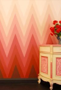 hombre zigzag wallpaper.  it's kind of like the red room in twin peaks got a much needed makeover :)