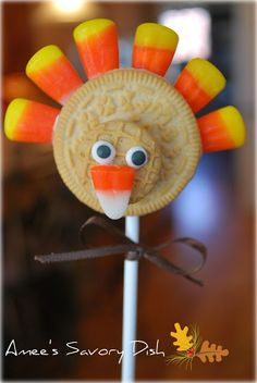 These cute turkey cookie pops are a fun food craft for kids for Thanksgiving using vanilla Oreos, candy corn and candy eyes.