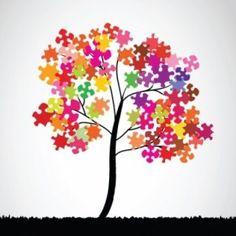 Herfstboom met oude puzzelstukjes of uitgeprinte puzzels op gekleurd papier