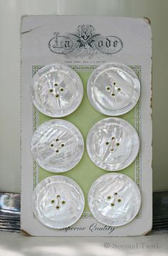 Antique Mother of Pearl Buttons on beautiful card.