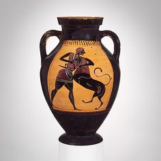 Terracotta amphora (jar)  Attributed to the Group of Brussels R 243     Period:      Archaic  Date:      ca. 540 B.C.  Culture:      Greek, Attic  Medium:      Terracotta  Dimensions:      H. 10 9/16 in. (26.9 cm)  Classification:      Vases