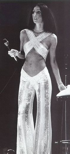 bob mackie designed all her gowns and outfirs...he still does!