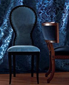 """""""Ann"""" chair in blue/navy striped """"Aspen""""from Pierre Frey and velvet-upholstered """"Regan"""" chair by Alexa Hampton for Hickory Chair. Background is """"Beaufort Silk"""" in delft blue from Northcroft Fabrics through John Rosselli."""
