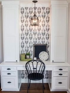 An enchanting wallpaper of rich Scandinavian influence brings a chic tulip design to walls in a sophisticated black hue, adding dynamic beauty to any space.