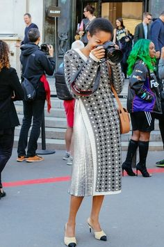 Tamu McPherson in a Creatures of the Wind dress, Pinko skirt, Chanel shoes, and 3.1 Phillip Lim bag spotted on the street at Paris Fashion Week. Photographed by Phil Oh.