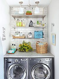 laundry area - covered in butcher block counter top material - white side by side bosch compact washer/dryer.
