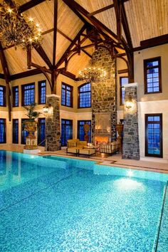 awesome indoor swimming pool designs spectacular pool decor massive chandeliers wood beams