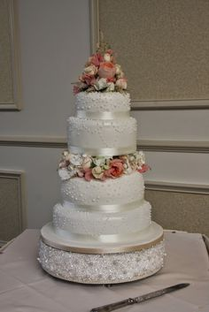 The magnificent Wedding Cake was dressed with a fresh flower topper and a garland of fresh flowers between the second and third tier
