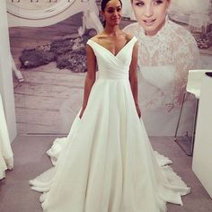 Love the clean lines on this gown by Ellis Bridals or dress it up a little with a glitzy belt - available now at Aimee bridal x