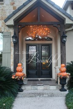 Fall front porch.  Can make string light porch chandelier using wicker branches from Joanne's or Michaels and wire together to create a bunch look, add orange string lights and run down along door. Cute!