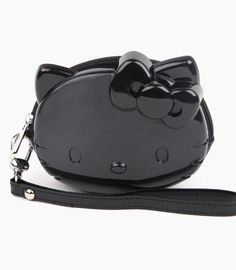 A cute wristlet in the shape of #HelloKitty - the perfect accessory for city breaks