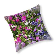 Decorative throw pillow with a lovely floral design that resembles a bouquet of flowers. This original design began as a photograph of various shades of blue, pink, purple and white flowers in the grass. I added some digital darkroom magic to create a unique design, with a painterly, watercolor effect.  This pillow will enhance your interior decor and will look good in any room, adding a somewhat vintage element that the design suggests.