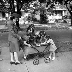 Little girls admiring a baby on Progress Avenue. Photograph by Alfred Eisenstaedt. Hamilton, Ohio, 1943.