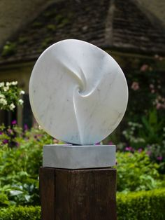 White Carrara Marble #sculpture by #sculptor Almuth Tebbenhoff titled: 'In 100 Lightyears turn left (Circular marble abstract Outdoor statue)'. #AlmuthTebbenhoff