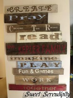 wall decor with stencilled words made from old wood shipping pallets
