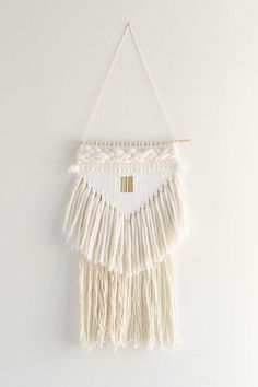 Hazel & Hunter White Triangle Wall Hanging, $200, Urban Outfitters