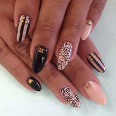 oval black & nude rosé nails with golden studs