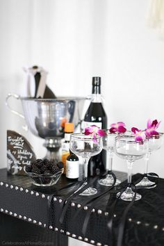 Host a ladies night cocktail party with these ideas for decorating, signature cocktail, food, and fun! Host this black & white & silver party as a precursor to a night out, or to watch the new movie, Fifty Shades Darker!