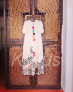 Cotton hand block printed floor length dress, layered with colourful embroidery! Little rosettes hang from the neckline. Indian Attire, Indian Outfits, Indian Wear, Ethnic Fashion, Indian Fashion, Women's Fashion, Hand Work Design, Half Saree Lehenga, Hand Painted Dress