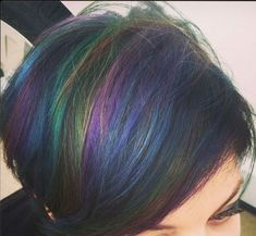 This bob shows off all the colors of the rainbow in a sophisticated, understated way with her oilslick hair color.