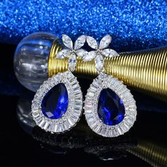 Sherdan Mart Jewelry has a unique collection of fashion jewelry with attractive designs and trendy look which gives you totally classy look with our jewelry and we guarantee you total satisfaction with our jewelry. Cubic Zirconia Earrings, How To Look Classy, Fashion Jewellery, Sapphire, Luxury, Store, Amazing, Stuff To Buy, Beautiful
