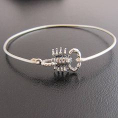 Sterling Silver Scorpion Bracelet - Halloween Bracelet - Scorpion Jewelry A sterling silver scorpion charm has been transformed into a scorpio bangle bracelet with a sterling silver band... Perfect for that Halloween jewelry accessory. This stacking bangle looks great together with