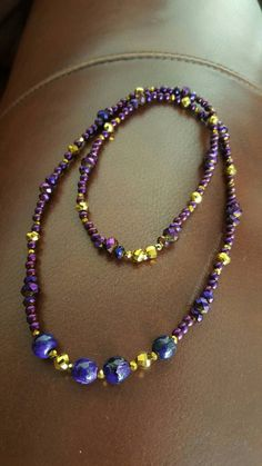 Check out this item in my Etsy shop https://www.etsy.com/listing/230109130/long-purple-and-gold-facet-bead-necklace