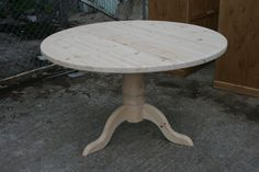 Beautiful hand made round pine table: http://www.pinefarmhousetable.co.uk/