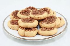 "Pecan Pie Cookies- I think I've found my cookie for the Christmas cookie swap.  I'm going to experiment by adding a tbsp. of Hersey's cocoa to make a chocolate version too.  I know my daughter, Stacy, and my hubby would be willing to eat the cookies that look less than ""perfect.""   :)"
