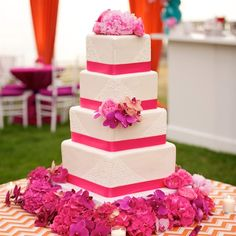 LOVE THIS!  Change the colors to gray and the flower to white and we are sold. Four-Tier Square Wedding Cake