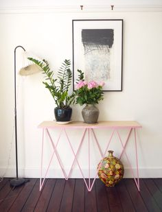 Giraffe steel console table in pink. #andnewfurniture