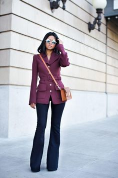 Sheryl of Walk in Wonderland has a knack for making retro trends look completely fresh and modern. Echo her chic '70s-inspired outfit by pairing a tailored double-breasted jacket with leg-lengthening flared jeans. Extra points for a jewel-tone hue and cognac accessories!