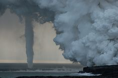strange weather pictures | DANGEROUS WEATHER - STRANGE VOLCANO DRIVEN WATERSPOUT