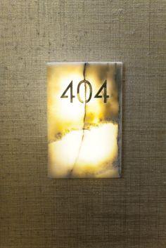 Onyx residences - custom onyx stone door plaques
