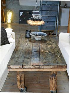 rustic coffee table on wheels- love this idea so you can move the table around to where you might need it (prop your feet up, work on your laptop)
