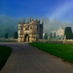The gatehouse Lanhydrock National Trust on a misty summer's morning. After a devastating fire in 1881, the Jacobean house was refurbished in high-Victorian style. When Thomas Charles refashioned Lanhydrock, he wanted to create 'an unpretentious family home'. While his idea of everyday comfort might be different from our own, there's no doubting the family is at the very heart of this house.