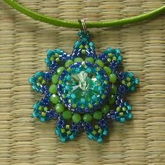 Lots Free DIY tutorial as well as many others on page - Beaded Pendant by diagram Orsi Beads: