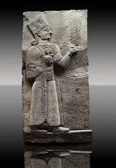 Picture & image of a Neo-Hittite orthostat showing a releif sculpture of the Goddess Kubaba from Karkamis - Turkey.  3 In her right hand she is holding a pomegranate. | © Paul E Williams 2013