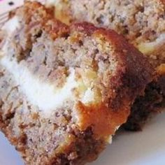 Cream Cheese filled Banana Bread:  I made this recipe today and just had a slice warm out of the oven.  Love it!  I followed the recipe but added a handful of chocolate chips to the cream cheese mixture.  Also added a few nuts, brown sugar and cinnamon on top.  I love that 3 bananas makes two loaves!  Eat one, freeze one!